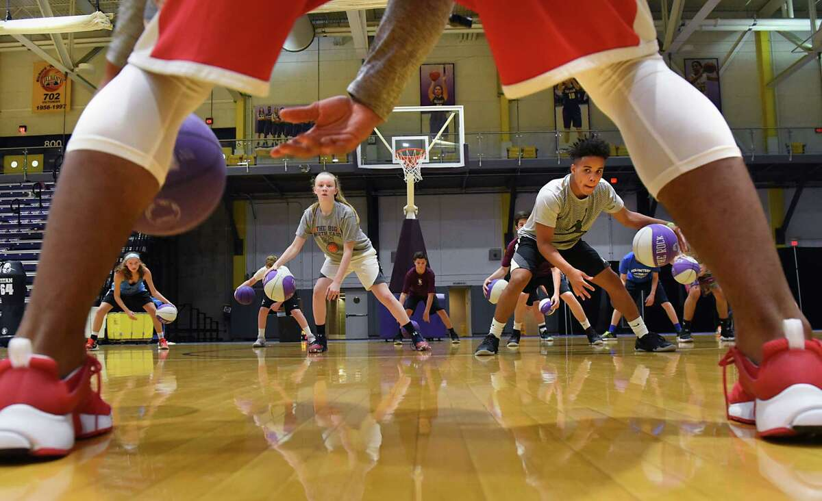 UAlbany basketall player David Nichols, foreground, leads a drill in dribbling during the Will Brown basketball camp at SEFCU Arena at University at Albany on Tues. Aug. 1, 2017 in Albany, N.Y. (Lori Van Buren / Times Union)