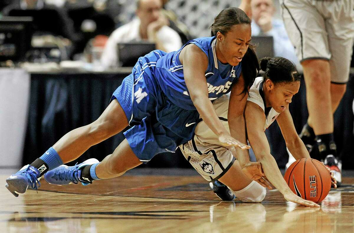 UConn's Moriah Jefferson, right, steals the ball from Memphis' Devin Mack, left, during Wednesday's game.