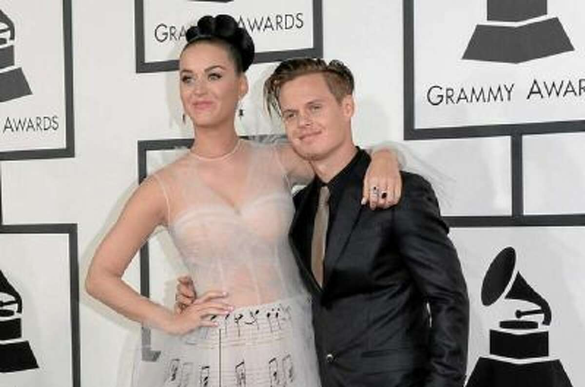 Katy Perry, in a sheer gown with a music-notes theme arrives with brother David Hudson at the 2014 Grammy Awards at Staples Center on Jan. 26, 2014, in Los Angeles.