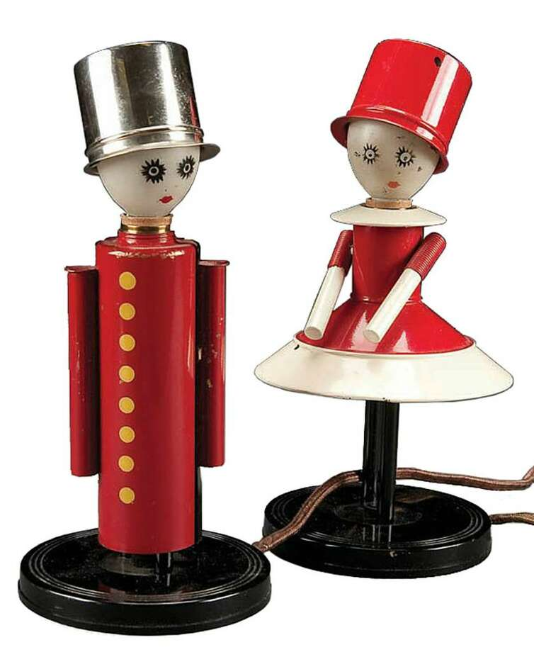 Chase Brass & Copper Co. made this pair of lamps, the Colonel and the Colonel's Lady, in about 1935. This pair sold recently for $300 at a Jackson's auction in Cedar Falls, Iowa. Photo: Contributed Photo / The News-Times Contributed