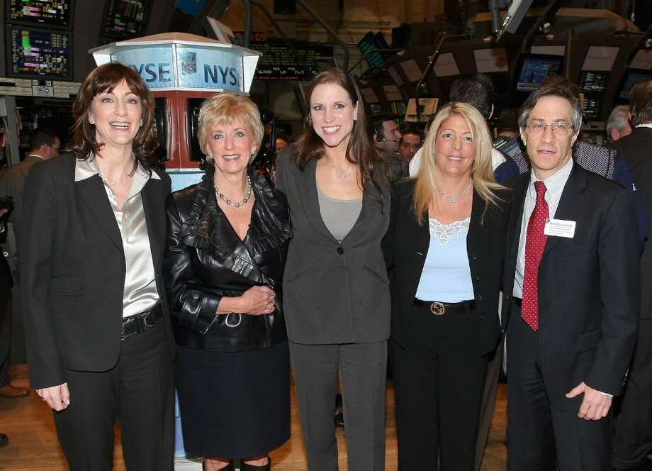 (L-R) WWE COO Donna Goldsmith, WWE CEO Linda McMahon, WWE EVP of Creative Development and Operations, Stephanie McMahon Levesque, WWE Marketing EVP Michelle Wilson and EVP and COO, U.S. Products, NYSE Group, Lawrence Leibowitz tour the floor after ringing the opening bell at the New York Stock Exchange on March 27, 2009 in New York City.  (Photo by Michael Loccisano/Getty Images) Photo: Michael Loccisano, Getty Images / 2009 Getty Images