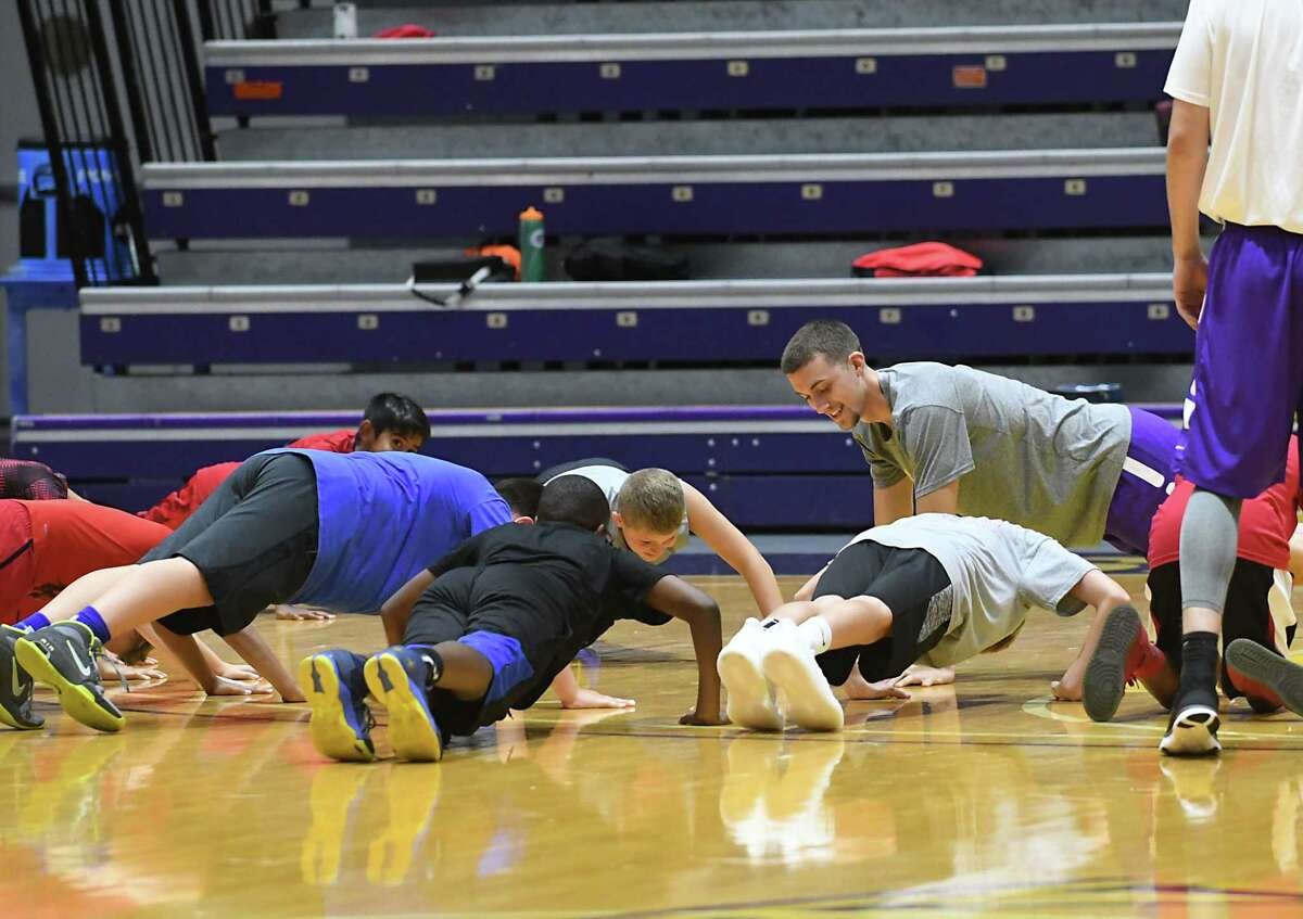 UAlbany basketball player Joe Cremo, from Scotia, performs pushups with kids during the Will Brown basketball camp at SEFCU Arena at University at Albany on Tues. Aug. 1, 2017 in Albany, N.Y. (Lori Van Buren / Times Union)
