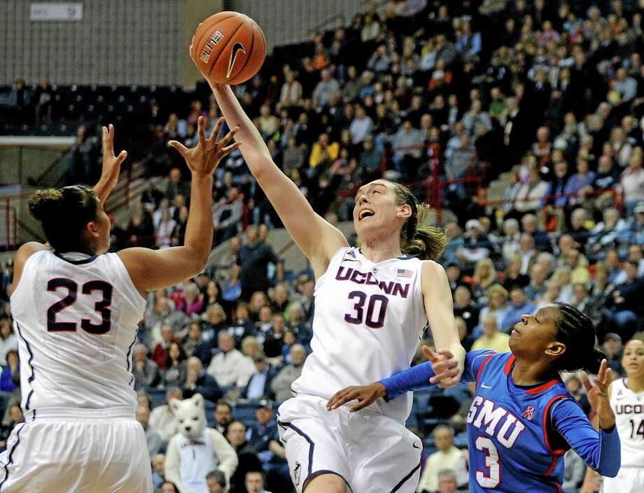 UConn's Breanna Stewart grabs a rebound as teammate Kaleena Mosqueda-Lewis (23) and SMU's Gabrielle Wilkins (3) look on during the first half Tuesday. Photo: Fred Beckham — The Associated Press   / FR153656 AP
