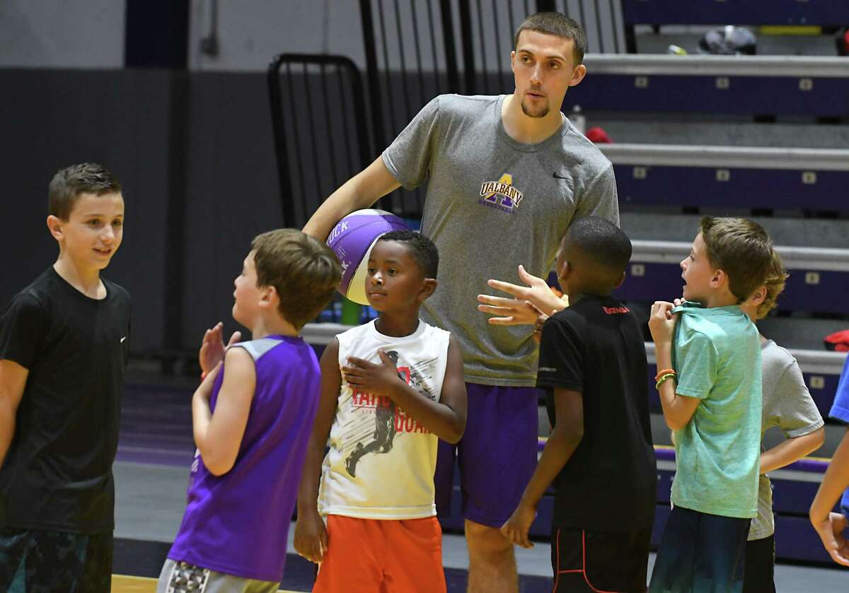 UAlbany basketball player Joe Cremo, from Scotia, talks to kids during the Will Brown basketball camp at SEFCU Arena at University at Albany on Tues. Aug. 1, 2017 in Albany, N.Y. (Lori Van Buren / Times Union)