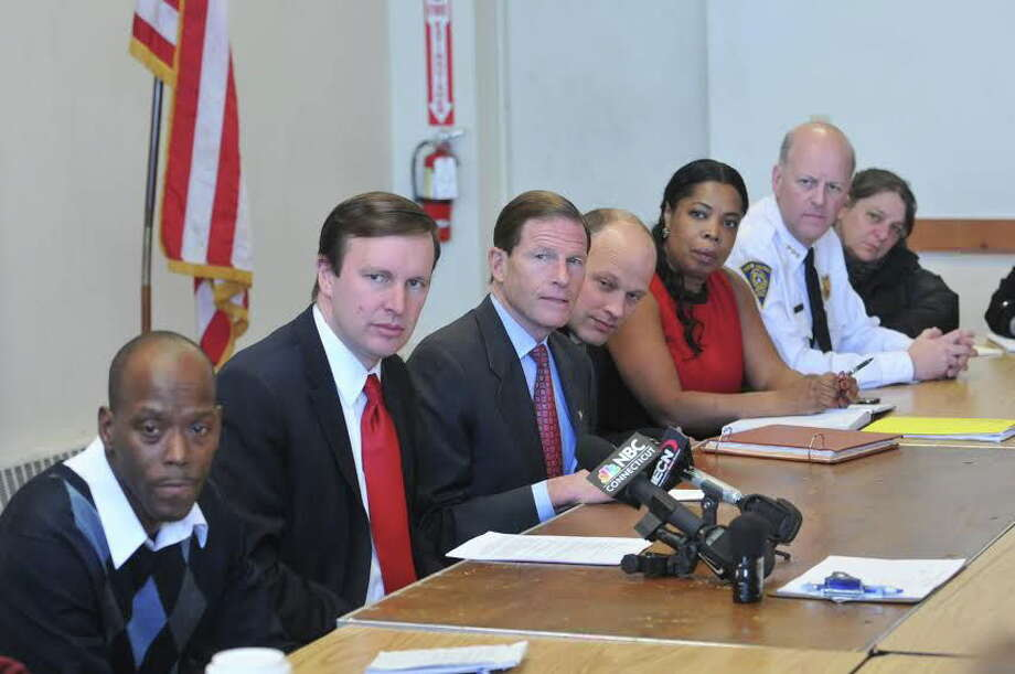 Sens. Chris Murphy and Richard Blumenthal, center, with community representatives. Photo: Peter Casolino — Register