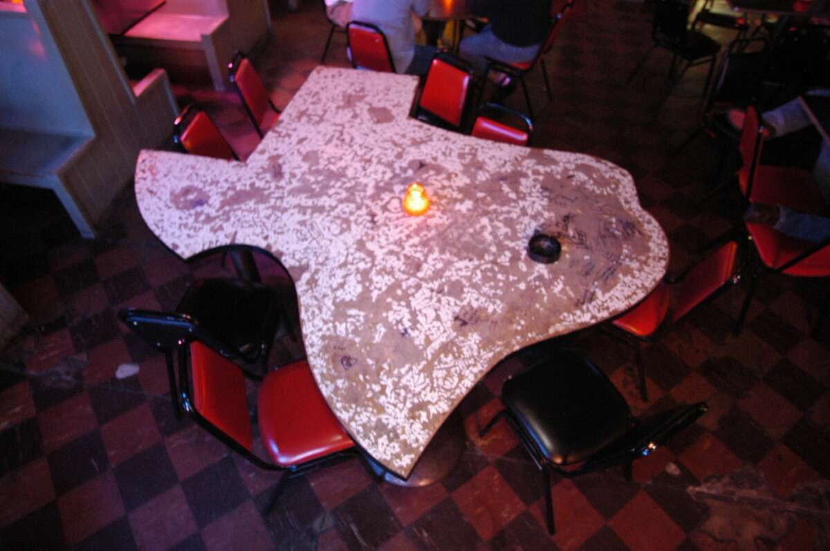 The famous Texas table at Kay's Lounge, which closed for good in late 2016.