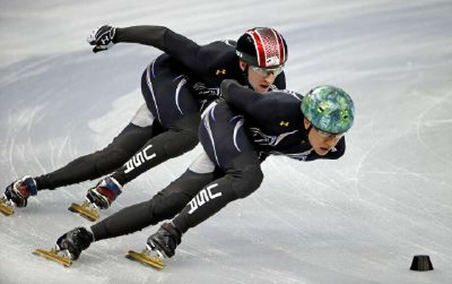 United States short track speed skating teammates J.R. Celski, right, and Christopher Creveling run through a training session at the Iceberg Skating Palace at the 2014 Winter Olympics, Sunday in Sochi, Russia.