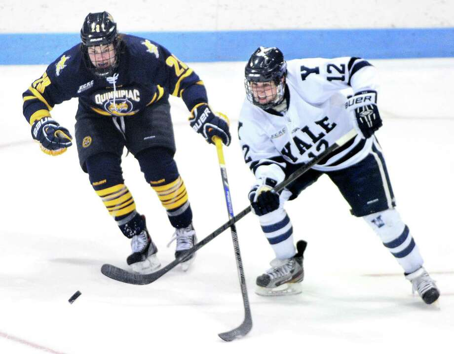 A night after losing to No. 4 Quinnipiac, above, Cody Learned, right, and No. 13 Yale beat Princeton Saturday at Ingalls Rink. Photo: Arnold Gold — Register