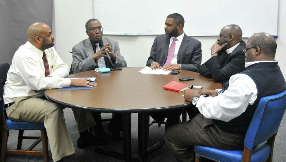 Community leaders sit down with Shahid Abdul Karim Thursday at the New Haven Register to discuss the Jordan Davis verdict. Photo: Peter Casolino - New Haven Register