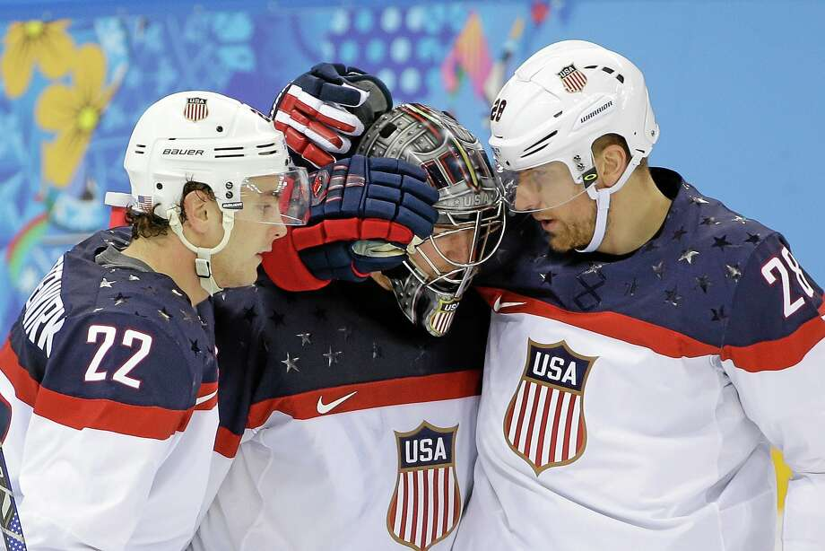 Goaltender Jonathan Quick of Hamden, center, defenseman Kevin Shattenkirk, left, and forward Blake Wheeler are one game away from playing for a gold medal at the Winter Olympics in Sochi, Russia. Photo: David J. Phillip — The Associated Press   / AP