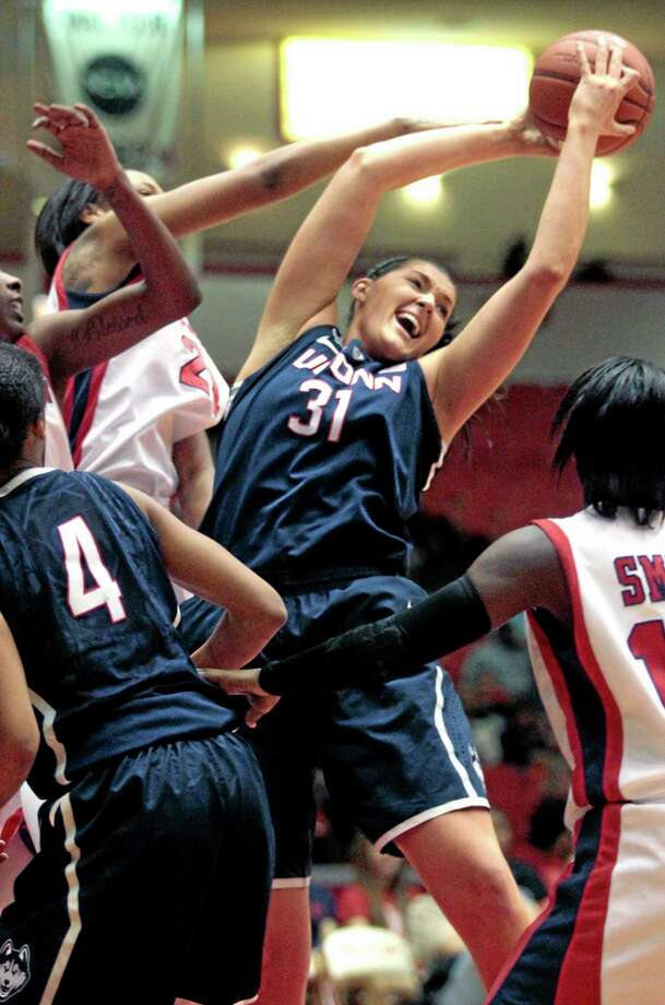 UConn center Stefanie Dolson brings down a rebound during the first half of the No. 1 Huskies' 92-41 win at Houston on Saturday. Photo: Patric Schneider — The Associated Press   / FR170473 AP