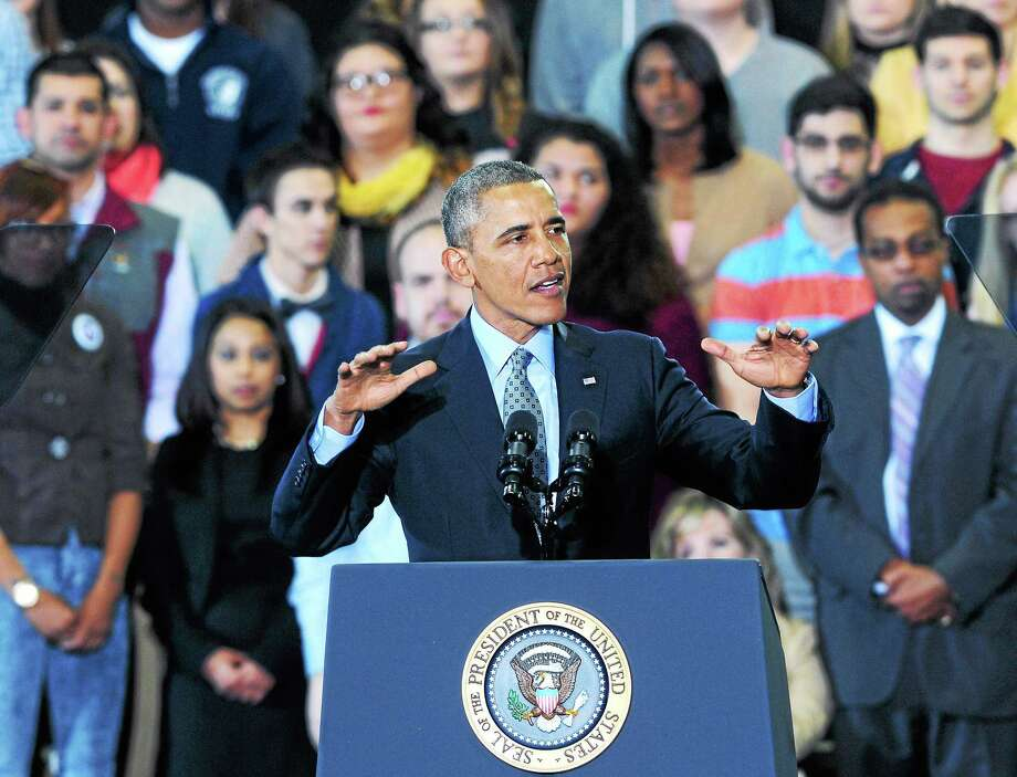 President Barack Obama speaks about raising the minimum wage at Central Connecticut State University in New Britain on 3/5/2014.  Photo by Arnold Gold/New Haven Register Photo: Journal Register Co.