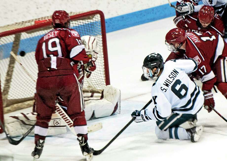 Yale's Stu Wilson scores the tying goal in the third period of Saturday's game against Harvard. Photo: Melanie Stengel — Register   / PETER HVIZDAK
