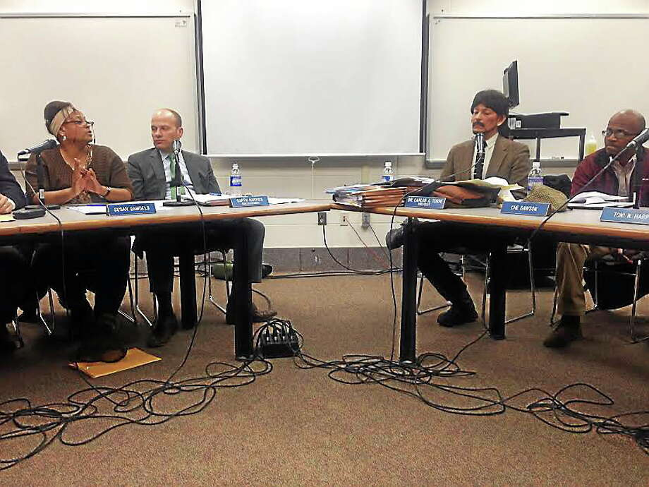 Superintendent Garth Harries, second from left, meets with the Board of Education Monday night. Photo: Rachel Chinapen/New Haven Register