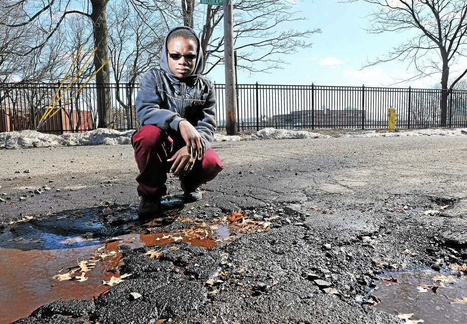(Peter Casolino-New Haven Register)    Sahim Hasan, 11, of New Haven has written a rap song about potholes in New Haven.  March 9, 2014.    pcasolino@NewHavenRegister Photo: Journal Register Co.