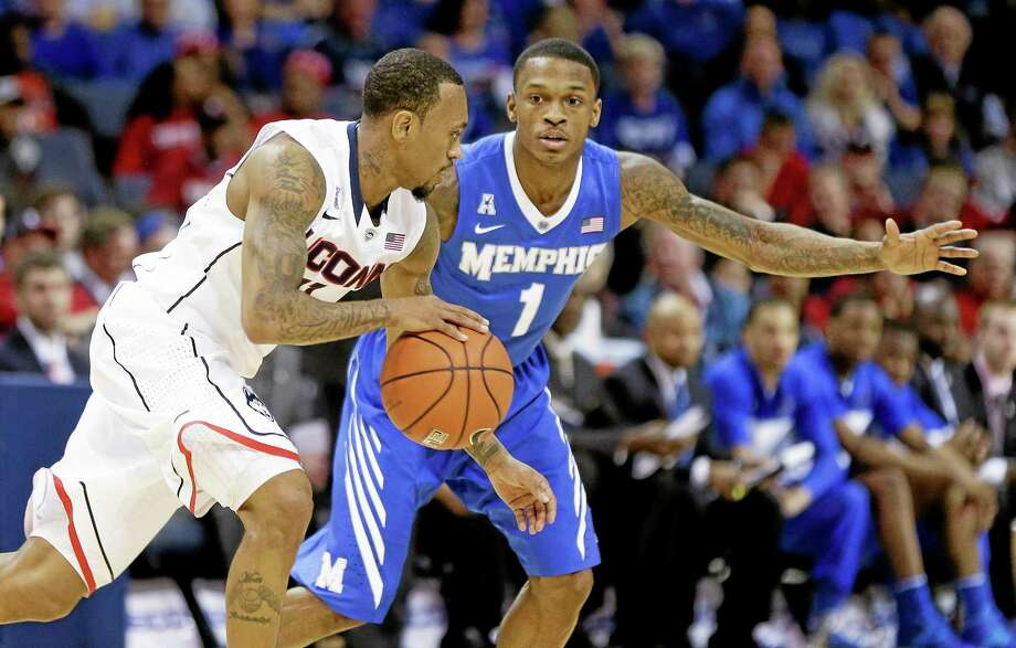 UConn's Ryan Boatright, left, drives against Memphis guard Joe Jackson during the first half of Thursday's game. Photo: Mark Humphrey — The Associated Press   / AP