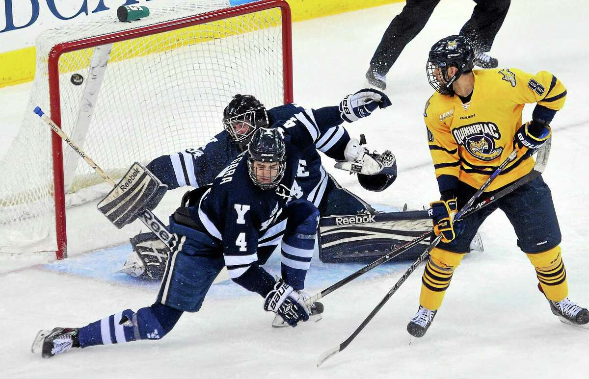 Quinnipiac's Alex Barron watches the first goal of the game go into the net past Yale goalie Alex Lyon and Rob O'Garra in the first period of the Bobcats' 5-3 win on Saturday night in Hamden.