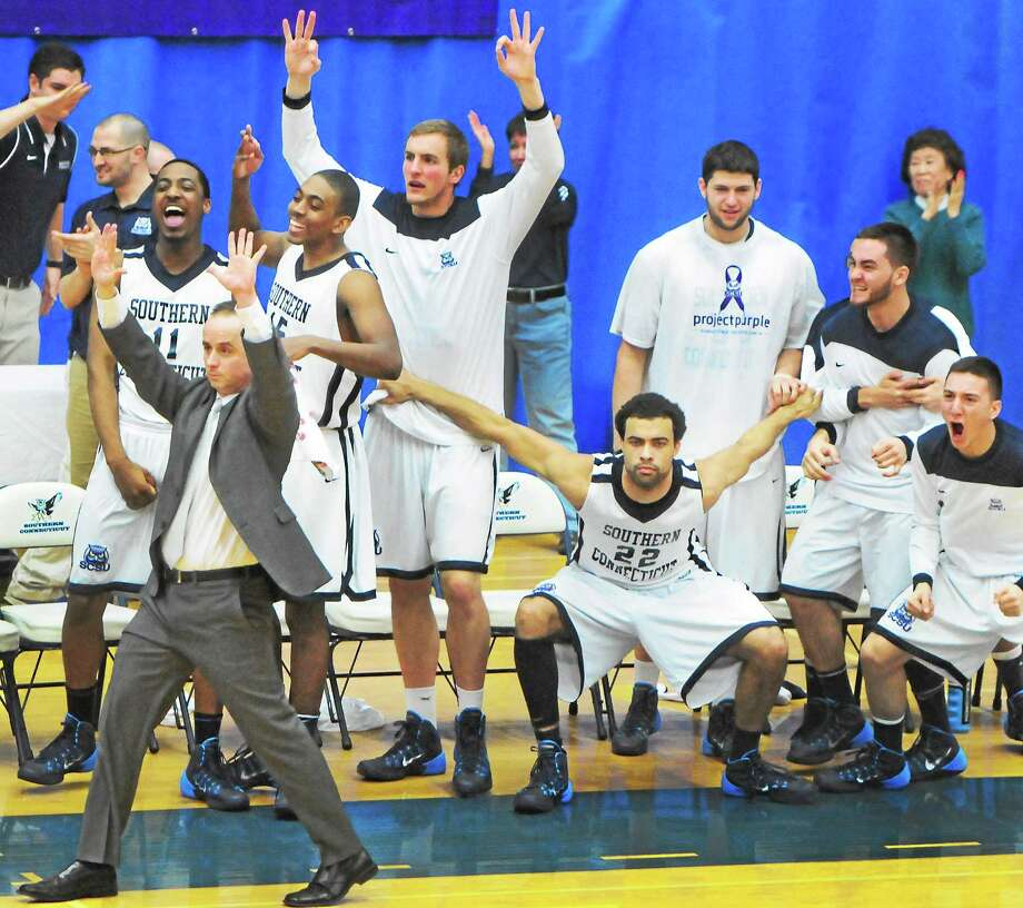 Southern Connecticut State had reason to celebrate again Saturday night after defeating Bridgeport 89-73 in the first round of the NCAA Division II men's basketball tournament at Moore Field House in New Haven. Photo: Peter Hvizdak — Register   / ©Peter Hvizdak /  New Haven Register