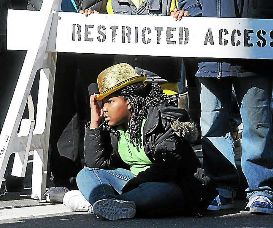 Attending the 2012 St. Patrick's Day Parade, New Haven. Rakia Bellamy age 9 of New Haven along the parade route. Photo by Mara Lavitt/New Haven Register Photo: Journal Register Co.