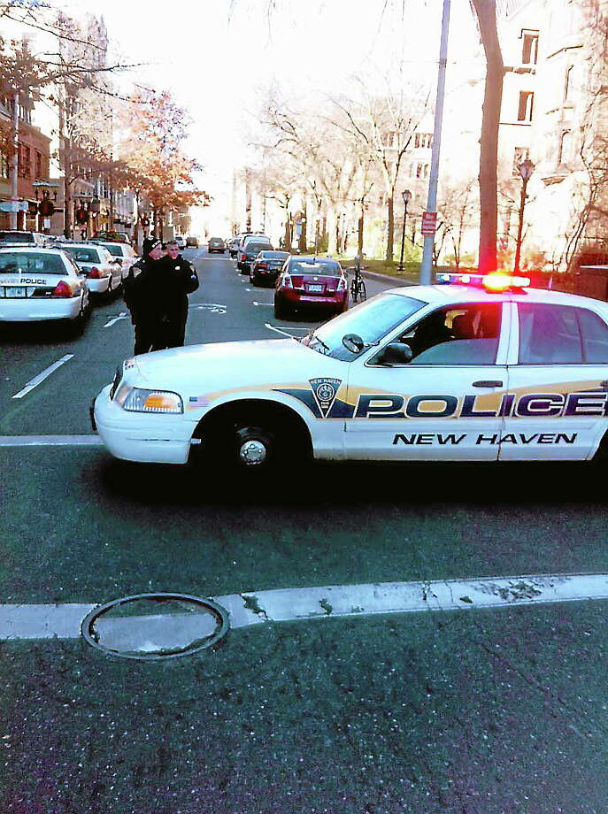 New Haven police blocking the intersection of College and Chapel. Photo: Arnold Gold — New Haven Register