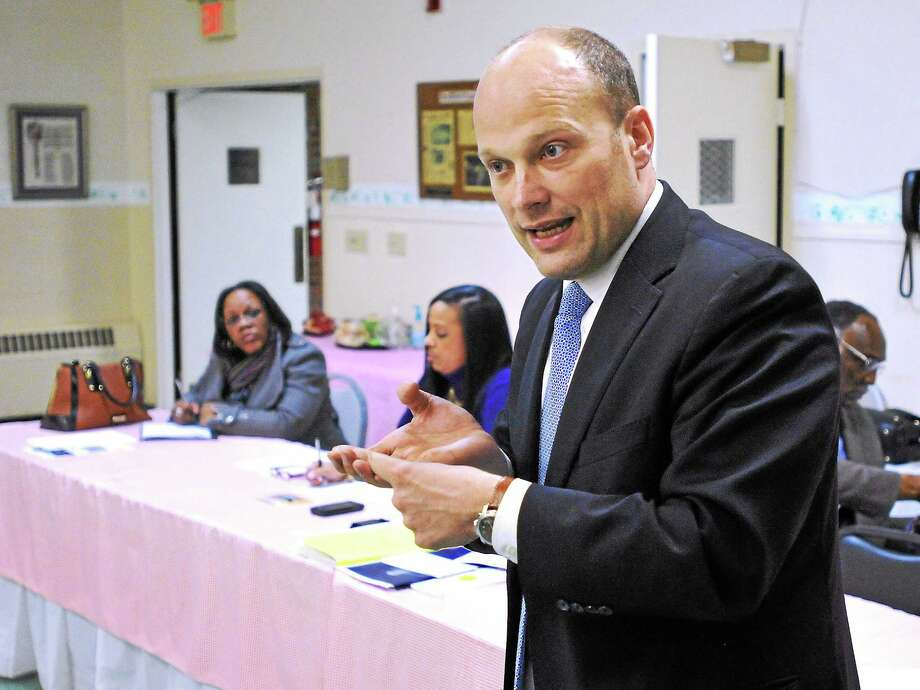 New Haven Superintendent of Schools Garth Harries speaks to the Greater New Haven Branch of the NAACP during a general meeting Thursday night at St. Lukes Church in New Haven. Photo: (Peter Casolino - New Haven Register)