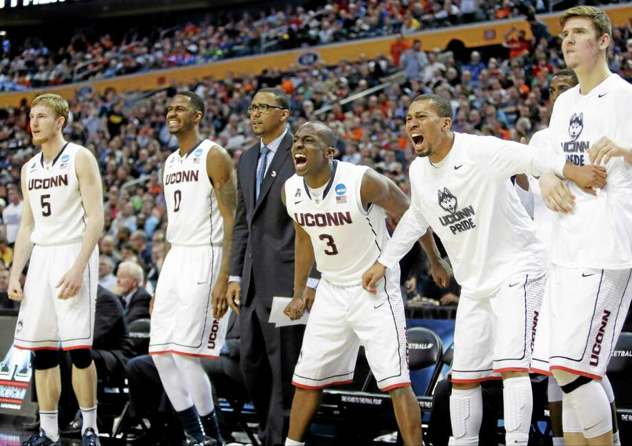 Members of the UConn bench cheer during overtime on Thursday. Photo: Nick LoVerde — The Associated Press   / FR1171125 AP