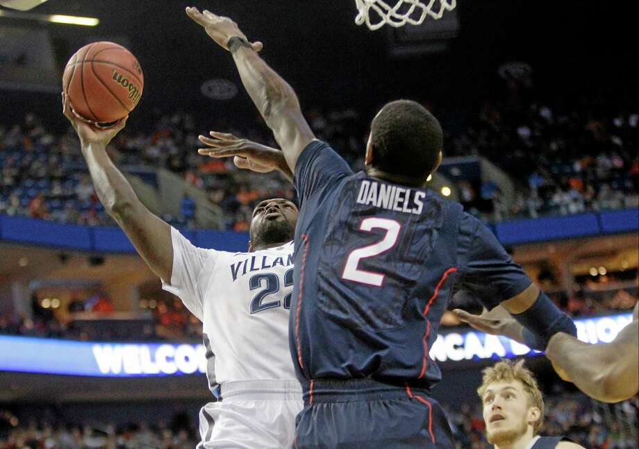 Villanova's JayVaughn Pinkston shoots over UConn's DeAndre Daniels during the first half of Saturday's NCAA tournament third-round game in Buffalo, N.Y. Photo: Bill Wippert — The Associated Press   / FR170745 AP