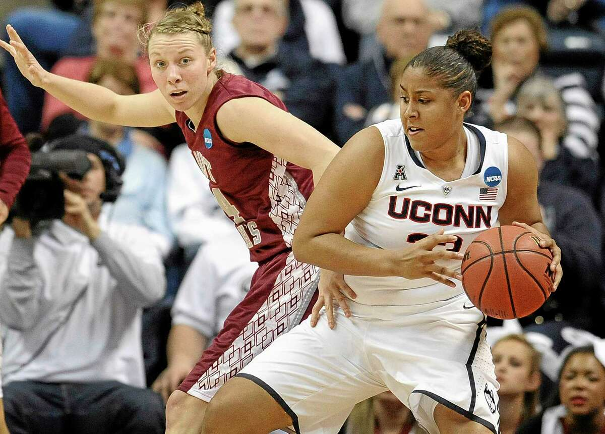 UConn's Kaleena Mosqueda-Lewis is guarded by Saint Joseph's Kelsey Berger, left, during the first half of Tuesday's second-round game in the NCAA women's basketball tournament, UConn won 91-52.