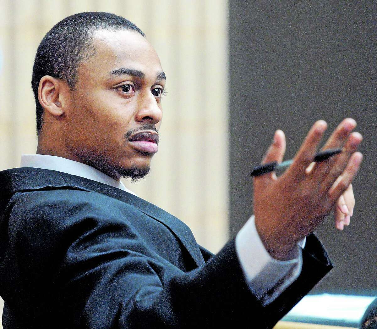 (Arnold Gold-New Haven Register) Cordaryl Silva gestures as his trial begins at Milford Superior Court on 4/1/2014.