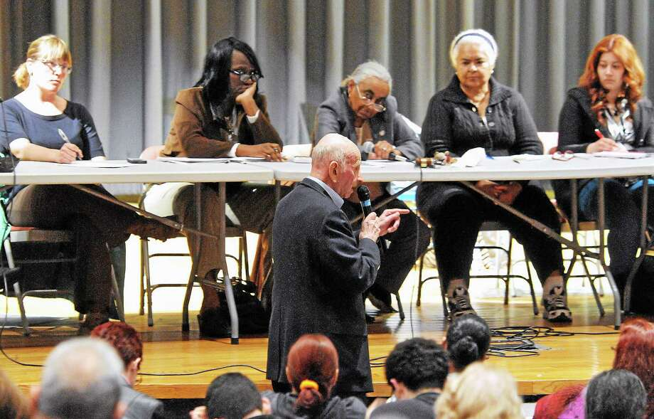 Don Dimenstein, retired director of the Department of Elderly Services in New Haven, explains the need for Hispanic outreach in New Haven during a public hearing in front of the aldermanic Finance Committee at Career High School Thursday. Photo: Peter Casolino — New Haven Register