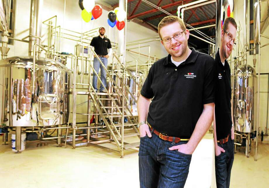 Overshores Brewing Co. owner Christian Amport, right, and lead brewer Brian Cox in the brewhouse area of the East Haven brewery Friday. Photo: Peter Hvizdak — New Haven Register    / ©Peter Hvizdak /  New Haven Register