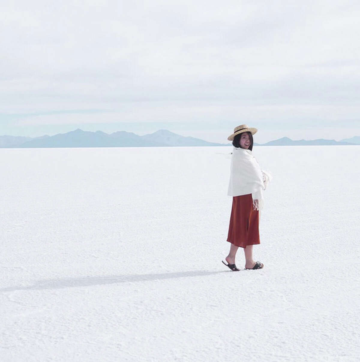 TJ Lee walks the Salt Flats in Bolivia. Lee quit her tech job and embarked on a journey around the world. Followers can keep up with her travels via social media.