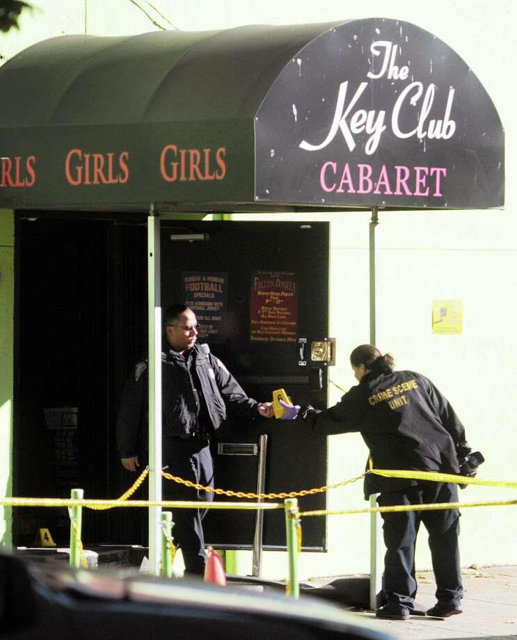 New Haven Police investigate the crime scene after a shooting at the Key Club Cabaret at 85 Saint John St. on Saturday October 26, 2013. Photo: (Peter Hvizdak - Register)    / ©Peter Hvizdak /  New Haven Register