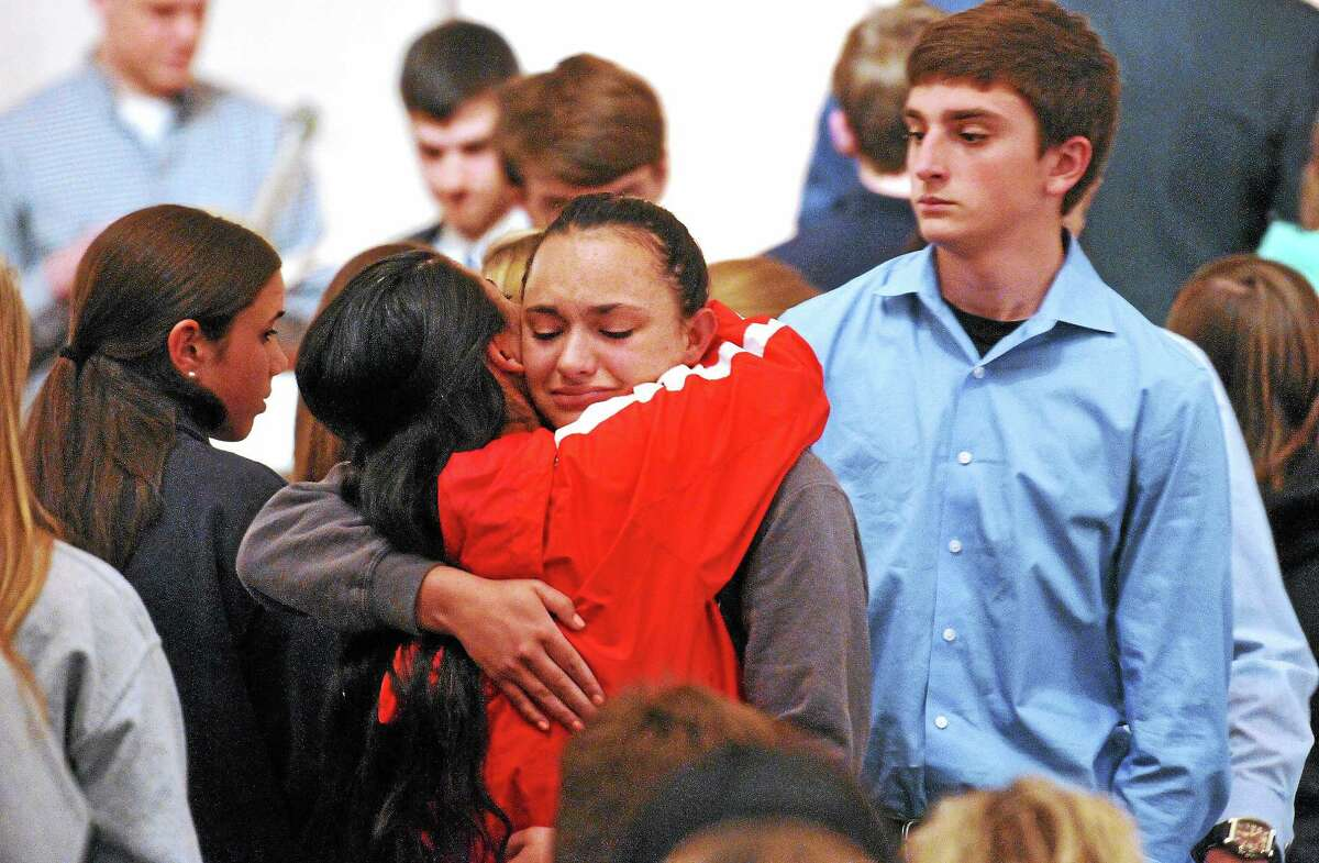 Friends and family including many students from Jonathan Law High School attend a memorial service at the First United Church of Christ for Maren Sanchez Friday night.