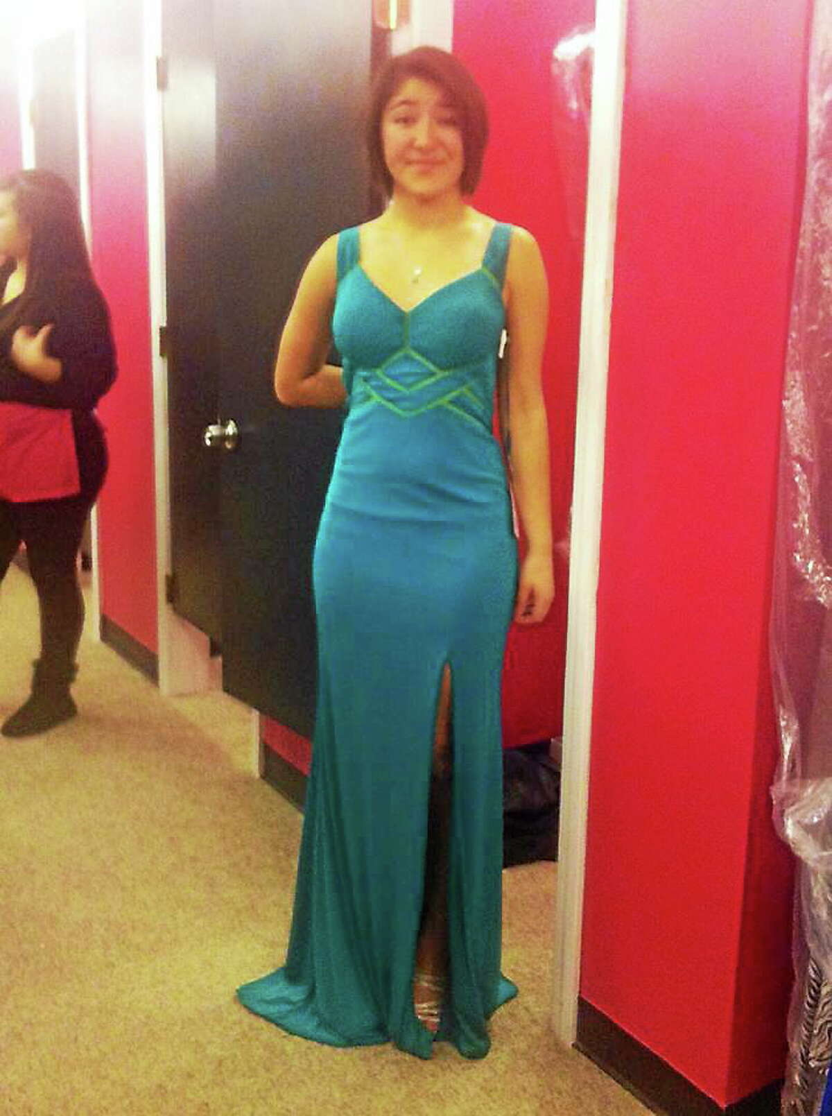 """Maren Sanchez posted a photo to Facebook """"JLHS Prom Dresses 2014"""" a photo of her trying on her prom dress on March 2 with the caption, """"Yay so excited!!"""""""
