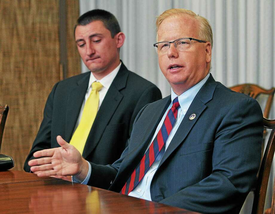 Danbury Mayor Mark Boughton, a Republican gubernatorial hopeful, speaks to the New Haven Register editorial board Wednesday. Behind him is campaign manager Heath Fahle. Photo: Peter Casolino — New Haven Register