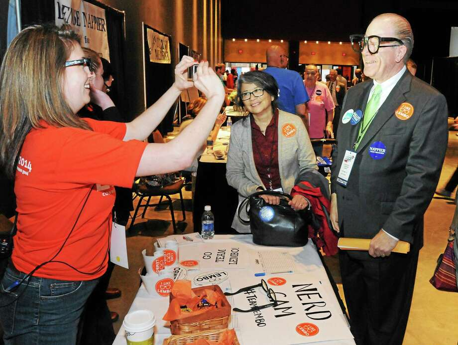 The 2014 Connecticut Democratic Convention is held at the Connecticut Convention Center in Hartford on May 16. Delegate Larry Goldman of Norwich gets his photo snapped by Comptroller Kevin Lembo's staffer Tara Downes wearing glasses that are cartoonishly like Lembo's own. Photo: (Mara Lavitt — New Haven Register) / Mara Lavitt