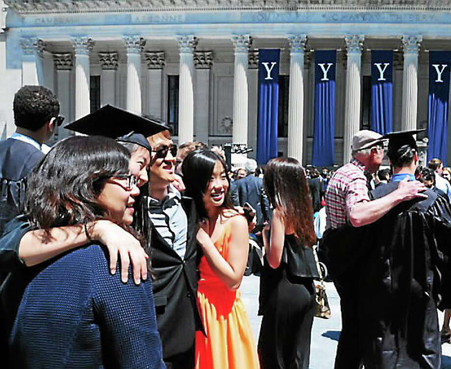 Students and parents take snapshots in Beinecke Plaza before Class Day ceremonies at Yale on May 18, 2014. (Arnold Gold/New Haven Register) Photo: Journal Register Co.