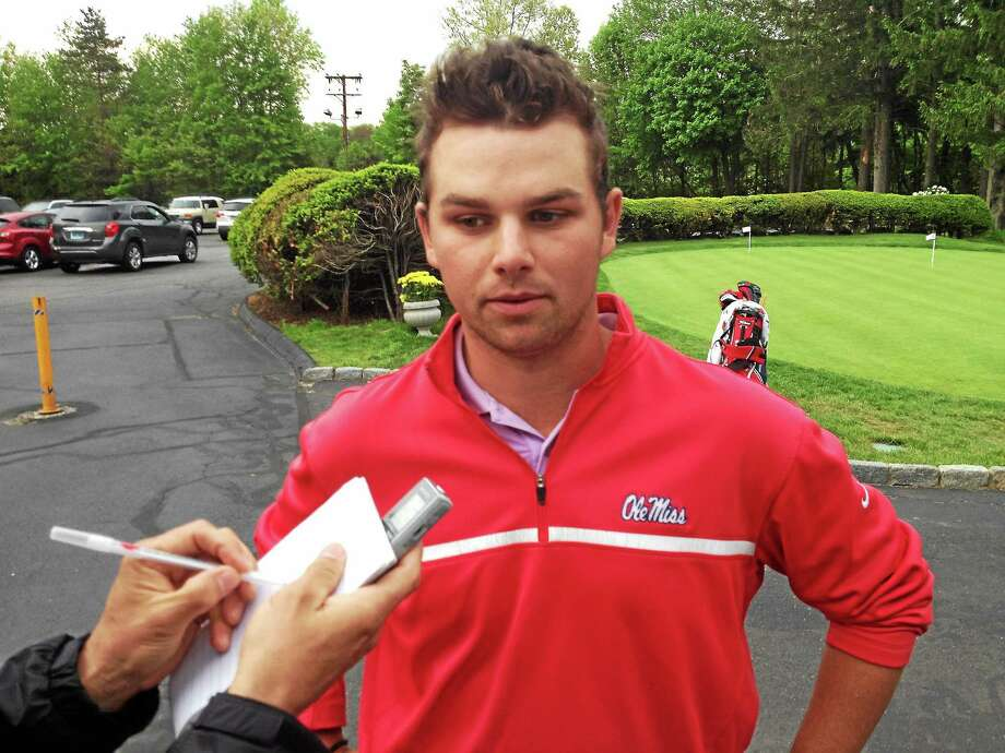 Blake Morris speaks to reporters after winning the Russell C. Palmer Cup amateur golf tournament. Photo: Joe Morelli - Register