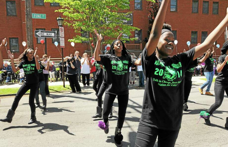 The Drill Nation drill team marchers perform in front of the Mary Wade Home on Clinton Avenue in New Haven Friday. Photo: Peter Hvizdak - New Haven Register   / ©Peter Hvizdak /  New Haven Register