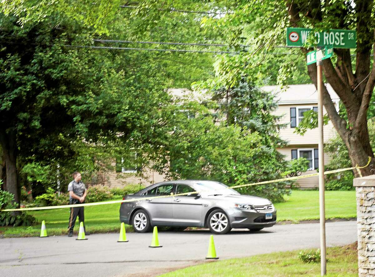 Orange police block off Wild Rose Drive as a homicide that occurred in the area Thursday is investigated.