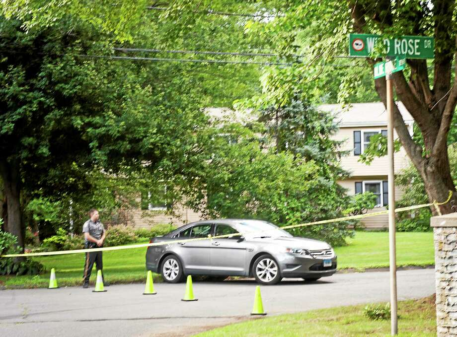 Orange police block off Wild Rose Drive as a homicide that occurred in the area Thursday is investigated. Photo: Melanie Stengel — New Haven Register