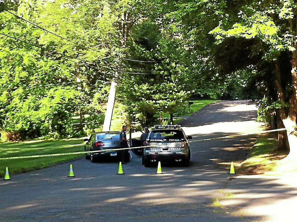 Police block Wild Rose Drive in Orange as a homicide that occurred in the area Thursday is investigated.