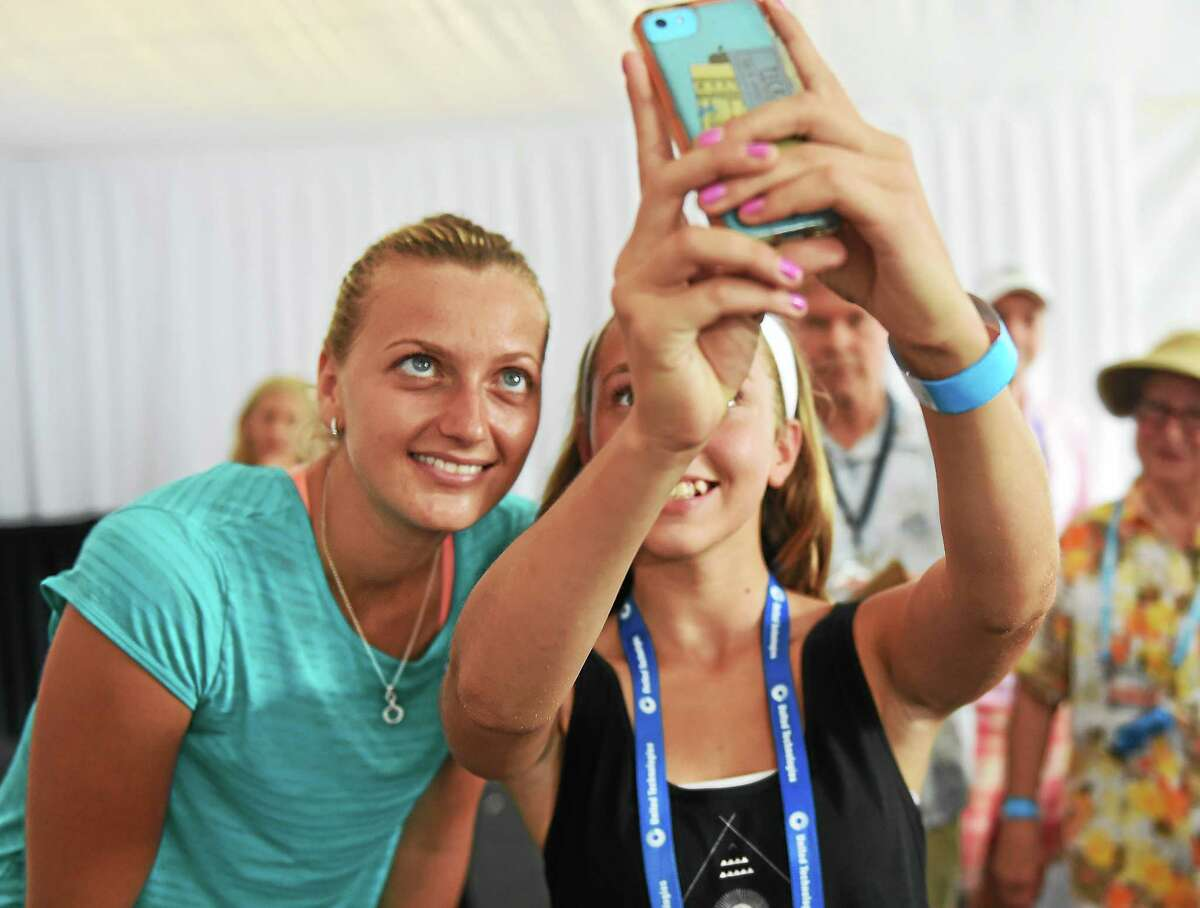 (Peter Hvizdak - New Haven Register) WTA Tennis player and Wimbleton Champion Petra Kvitova has an iPhone selfie photo taken with fan Maddie Constantino, 13, of Guilford, Connecticut Sunday, August 17, 2014 at the WTA Connecticut Open tennis tournament in New Haven, Conn.