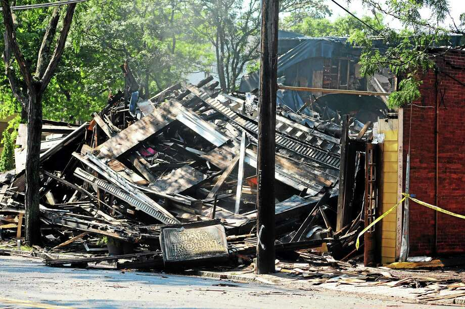 Cleanup begins after a fire Monday night destroyed Delaney's Restaurant & Tap Room, 882 Whalley Ave. in New Haven. Photo: Peter Hvizdak — New Haven Register   / ©2014 Peter Hvizdak