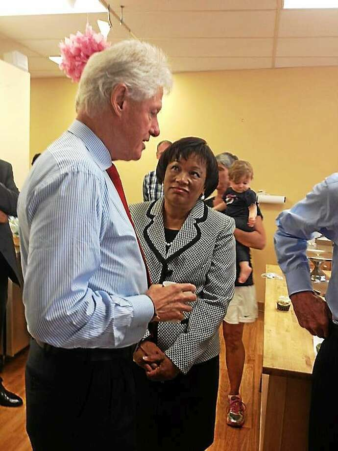 Former President Bill Clinton took a tour in the Katalina's bakery Kitchen kitchen with the staff. Talks business with Toni Harp. Photo: Journal Register Co.
