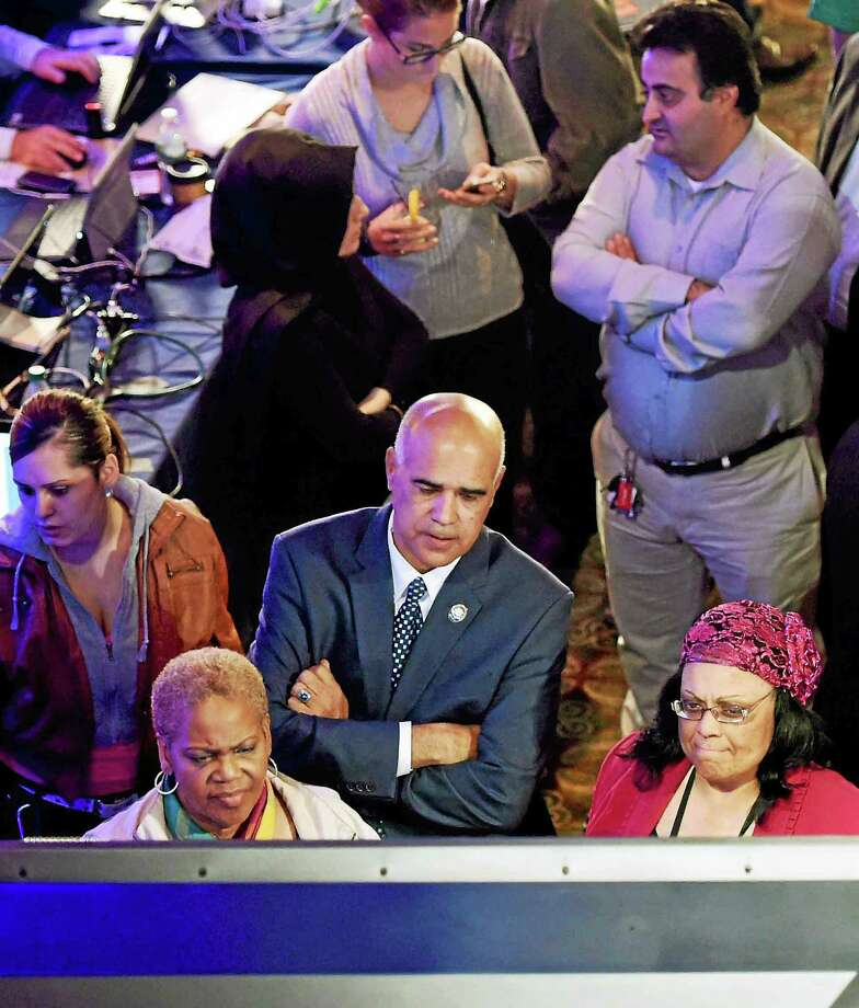 Democrats and supporters of Gov. Malloy wait for poll results at The Society Room in Hartford during a close race against Republican challenger Tom Foley November 4, 2014. Photo: (Peter Hvizdak — New Haven Register)   / ©2014 Peter Hvizdak