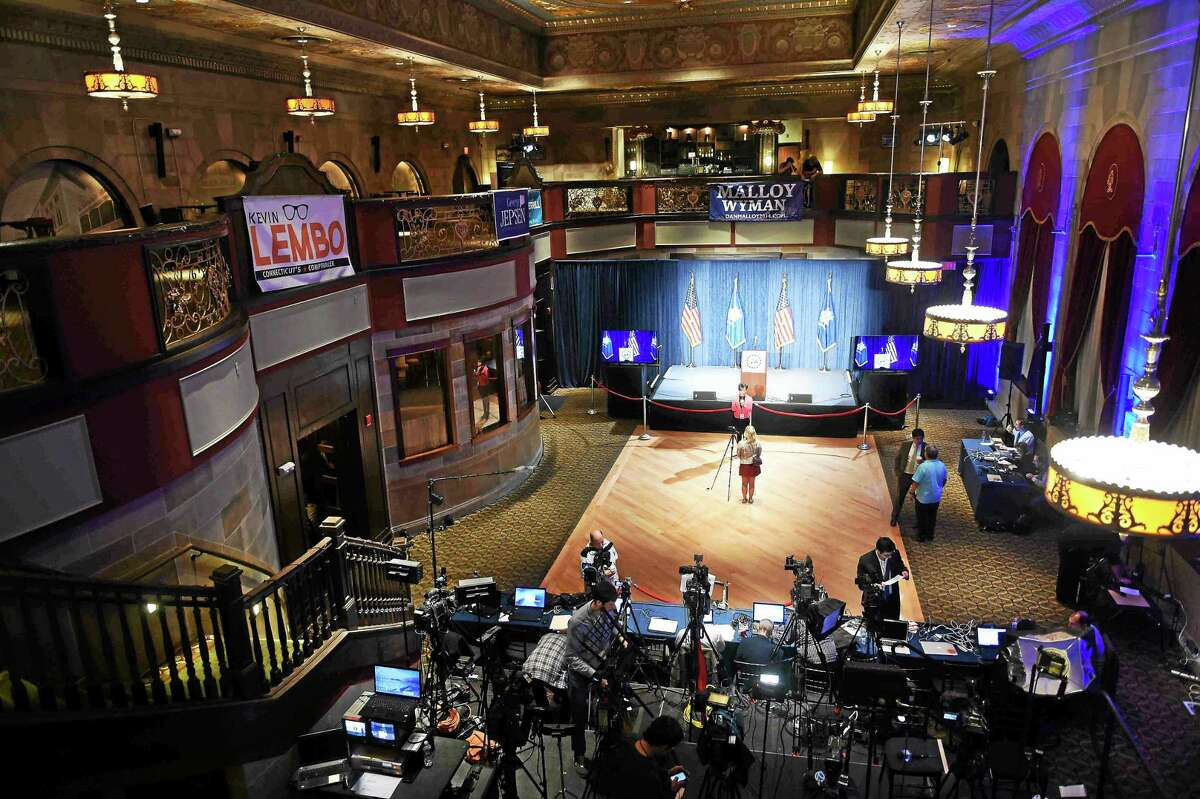 (Photo by Peter Hvizdak - New Haven Register) Reporters, photographers and technicians work on early stories, setting up lights, cameras, tv positions and work areas early on election night Tuesday , November 4, 2014 at The Society Room in Hartford where Governor Dannel P. Malloy will make an appearance after the voting results are tallied.