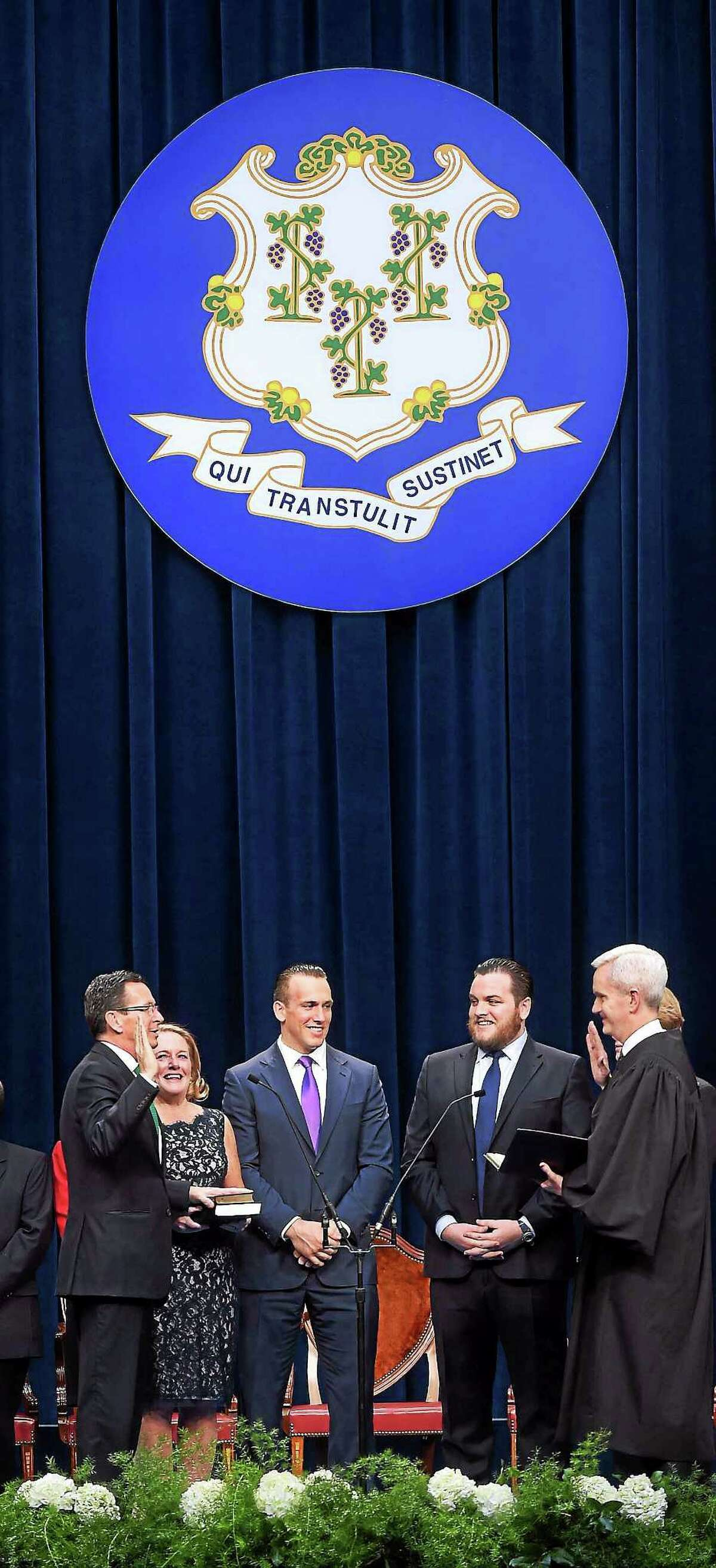(Arnold Gold — New Haven Register) Governor Dannel P. Malloy (left) is sworn into office by Connecticut Supreme Court Justice Andrew J. McDonald (right) in the William A. O'Neill State Armory in Hartford on January 7, 2015.