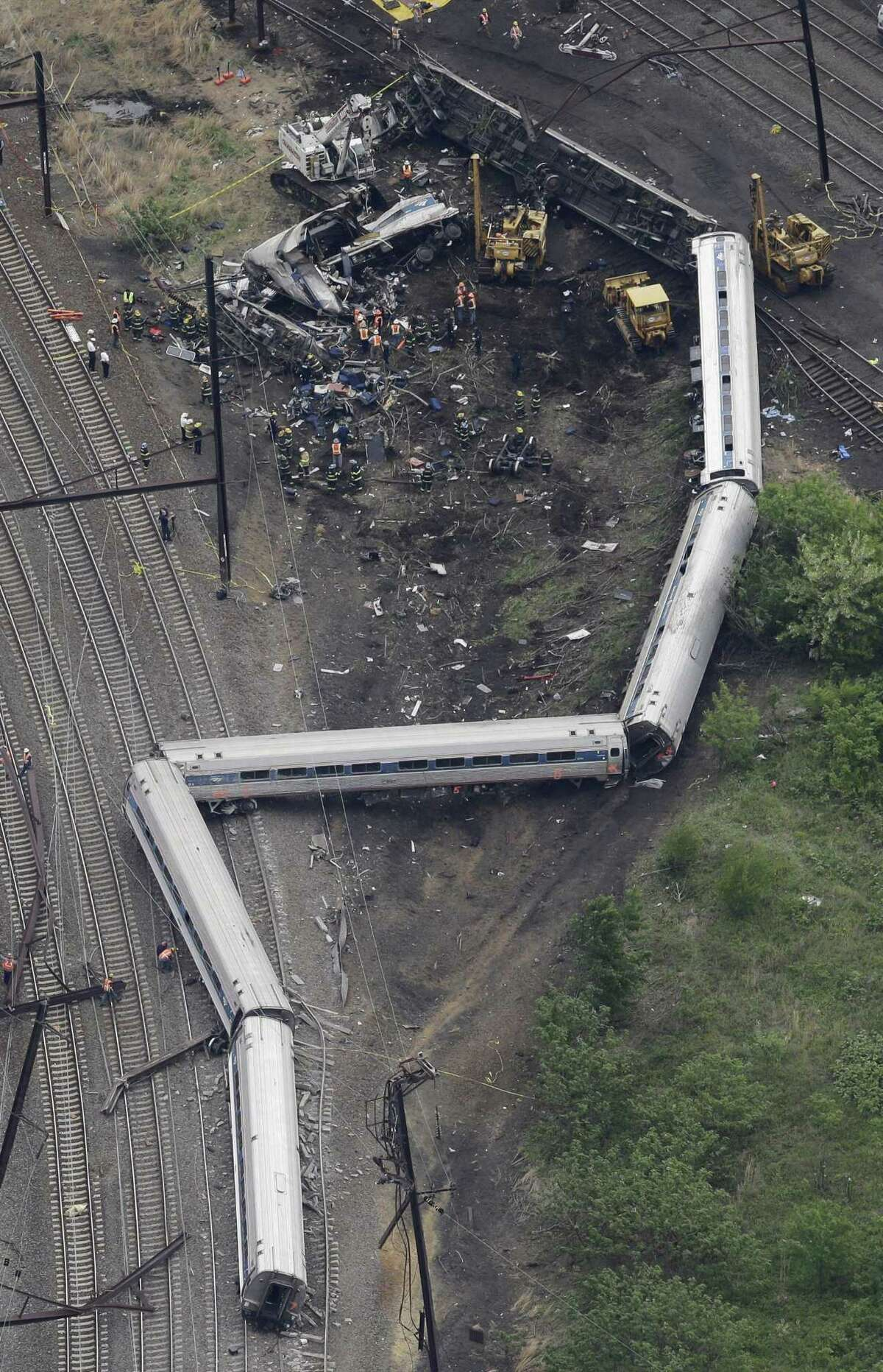 Emergency personnel work at the scene of a deadly train derailment Wednesday in Philadelphia.